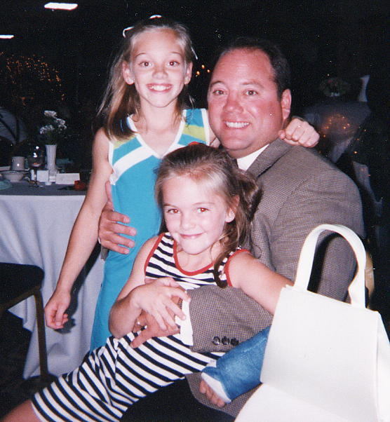 Samantha and Jessica with their father Ed